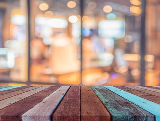 wood table and blur restaurant for background.