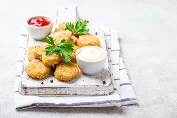 Fried crispy chicken nuggets with popular sauces Wall mural