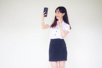 Portrait of thai adult student university uniform beautiful girl using her smart phone Selfie
