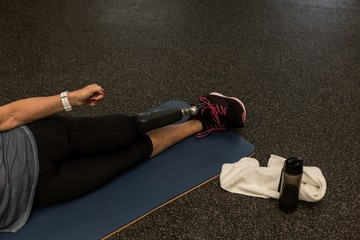 Disabled woman performing stretching exercise