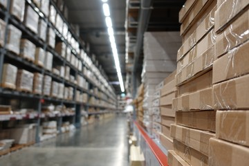 Perspective and depth of field of Large hangar warehouse industrial and logistics companies. Warehousing on the floor and called the high shelves.