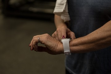 Woman using smartwatch in the gym