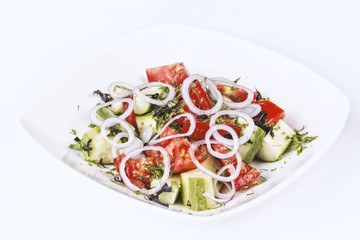 Healthy salad with tomato, cucumber, onion and herbs