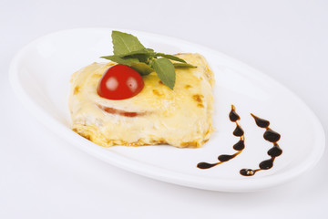 Meat baked with cheese and tomato. Lasagna