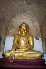 Buddha statue painted in gold meditation