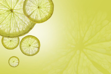 Flat lay Slice of lemon on green background , space for text