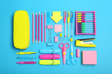 Flat lay composition with different school stationery on color background