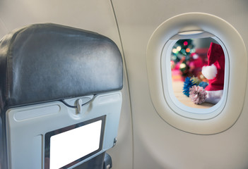 seat and window on airplane.