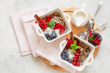 Healhty vegan breakfast bowl. Quinoa with cinnamon and fresh berries overhead
