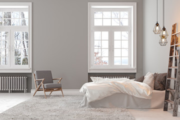 Scandinavin loft gray empty bedroom interior with armchair, bed and lamp.