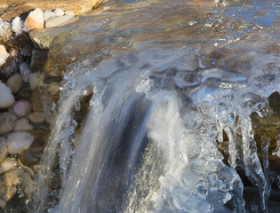 Waterfall running with ice atop