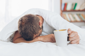 Man trying to wake up in the morning