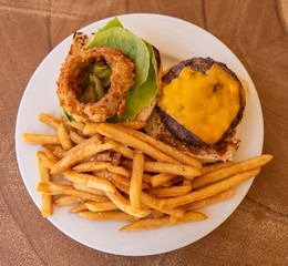 Cheeseburger Plate With French Fries And Onion Ring