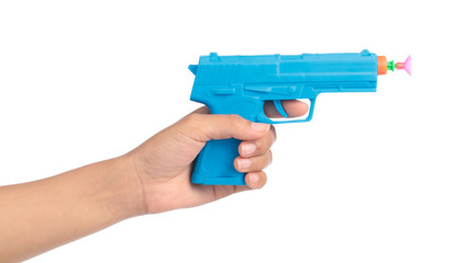 hand holding Toy Gun made of plastic isolated on white background