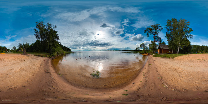 Beach at the lake with blue sky. 3D spherical panorama with 360 degree viewing angle. Ready for virtual reality in vr. Full equirectangular projection. Beautiful background.