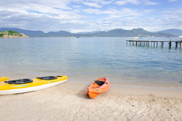 kayak and small boat on the beach