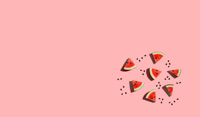 Sliced watermelons arranged on a pink background