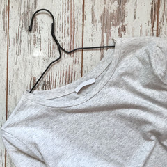 Gray T-shirt on a wooden background