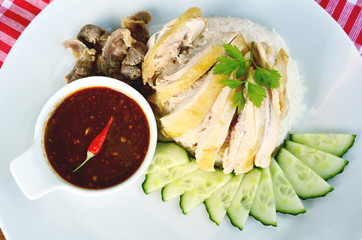 Hainanese chicken rice, steamed chicken and white rice (Thai name is Khao Man Kai)