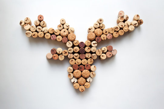 Wine corks deer head silhouette isolated on white background from a high angle view