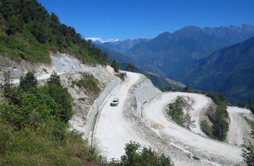 Long and winding dusty gravel road from Sekha to Num, Himalayan mountain region, eastern Nepal