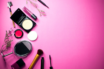 top view of fashion pink cosmetic makeup with background