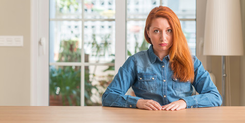 Redhead woman at home depressed and worry for distress, crying angry and afraid. Sad expression.