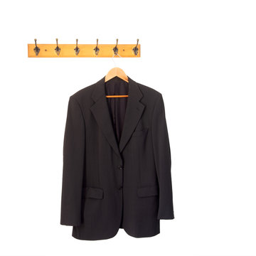 Mans grey suit jacket on hanger, hung up and isolated on white. Retirement, redundancy concept or working late.