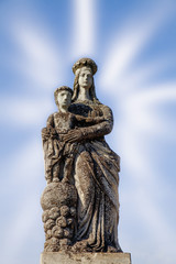 Ancient statue of the Virgin Mary with Jesus Christ in the rays of fame