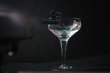 Broken glass in front of black background photographed under the name glass shards cocktail