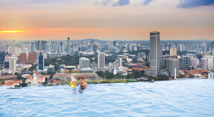Kids swim in Singapore roof top swimming pool
