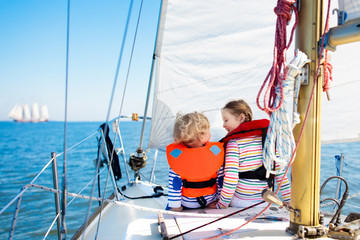 Kids sail on yacht in sea. Child sailing on boat.