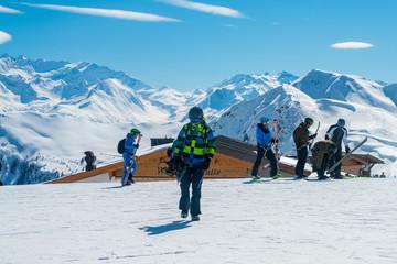 Young man enjoying beautiful mountain view in the Alps. Amazing nature. Winter ski resort.