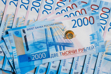 Background of two thousandths Russian banknotes