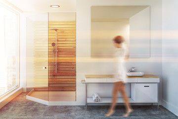 Luxury white bathroom sink and shower, woman