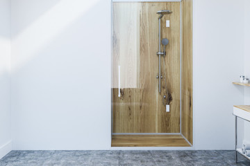 Wooden shower stall in white bathroom