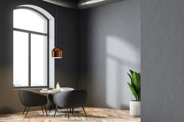 Cozy table in a gray wall restaurant interior