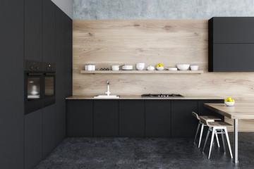 Black and wooden kitchen interior