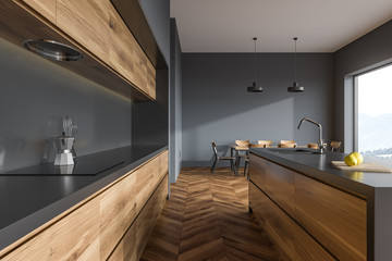 Wooden floor gray kitchen, side view close up