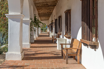 Long Colonnade of Plaster and Wood at San Luis Rey Mission, California