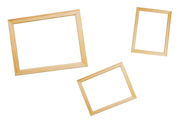 Wooden frames of different sizes for photos. White isolate.