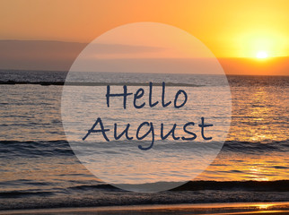 Hello August greeting on ocean sunset background.Summer concept. Selective focus.