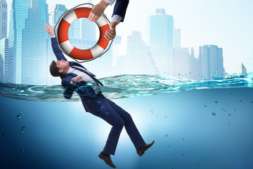Businessman being saved from drowning Fototapete