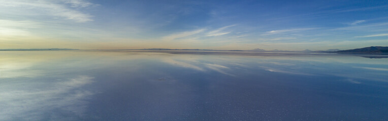 Aerial Uyuni reflections are one of the most amazing things that a photographer can see. Here we can see how the sunrise over an infinite horizon with the Uyuni salt flats making a wonderful mirror.