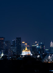 Wall Mural - The golden mount, Wat Saket in Bangkok city, surround by modern buildings