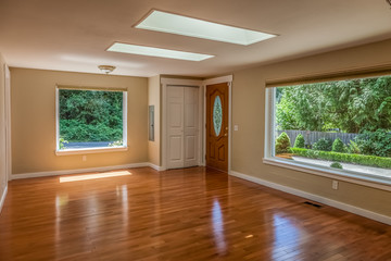 empty living room with wood floors