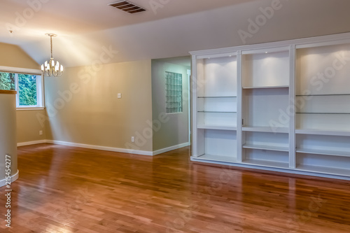 Empty Contemporary Formal Dining Room With Built In Display Shelves