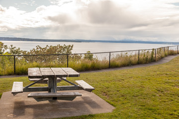 picnic table in park overlooking water
