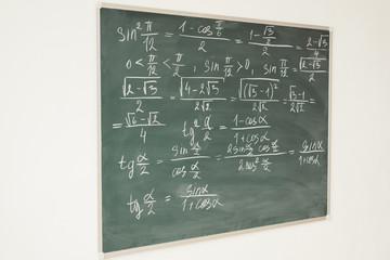 Mathematics formulas written on the chalkboard. School, lesson, education.