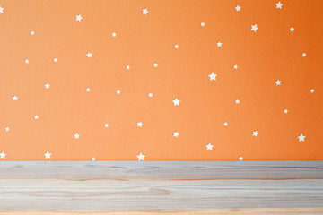 Kids table and starry orange wall